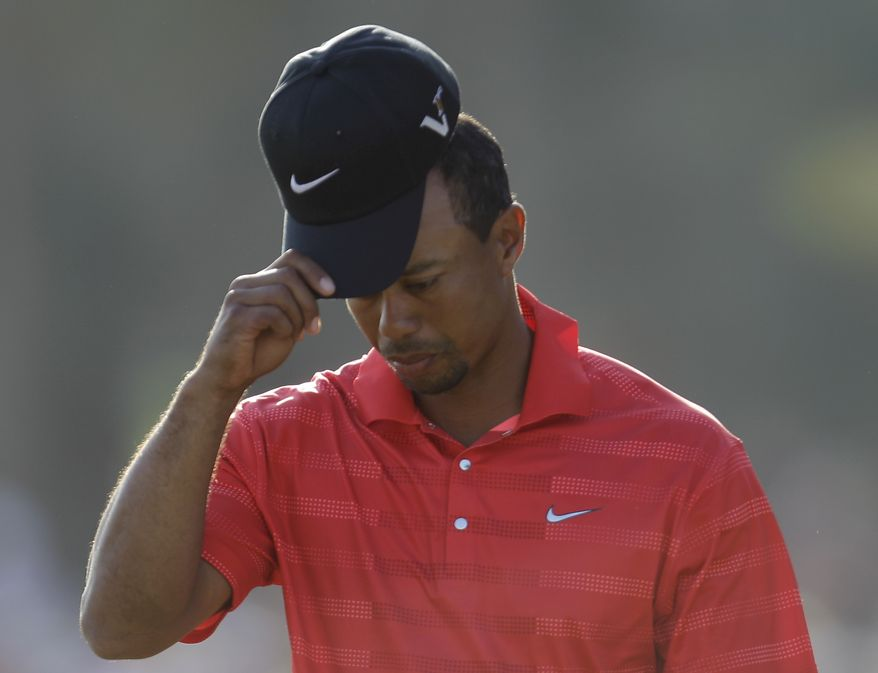 Tiger Woods from the U.S. reacts after he walks on the 18th hole during the final round of the Abu Dhabi HSBC Championship, Sunday, Jan. 29, 2012 in Abu Dhabi, United Arab Emirates. Woods finished in a tie for third. (AP Photo/Kamran Jebreili)
