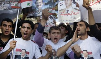 Protesters shout slogans as they carry pictures of Syrian President Bashar Assad and Syrian flags during a demonstration on Jan. 29, 2012, in front of the Russian Embassy in Beirut to express gratitude for the Russian position in support of Syria. (Associated Press)