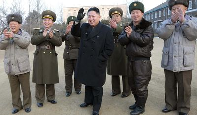North Korean leader Kim Jong-un (center) waves during his visit to the Korean People's Army (KPA) Air Force Unit 354 at an undisclosed location in North Korea in this undated photo. (AP Photo/Korean Central News Agency via Korea News Service)