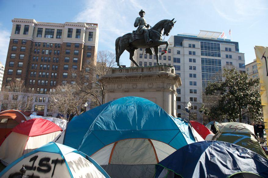 Tents still remain throughout McPherson Square less than an hour before the deadline set by the National Park Service for Occupy D.C. protesters to remove camping material from the square and Freedom Plaza in Washington on Monday, Jan. 30, 2012. (Andrew Harnik/The Washington Times)