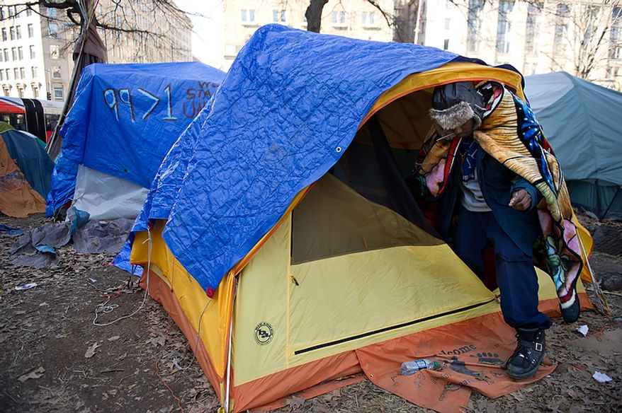 Occupy DC Protester Kevin Wiley of Silver Spring, Md. clears out all camping material out of his tent at McPherson Square, Washington, DC, Monday, January 30, 2012.  Tents still remain throughout McPherson Square less then an hour before the deadline set by the National Park Service for Occupy DC protesters to remove camping material from McPherson Square and Freedom Plaza. (Andrew Harnik / The Washington Times)