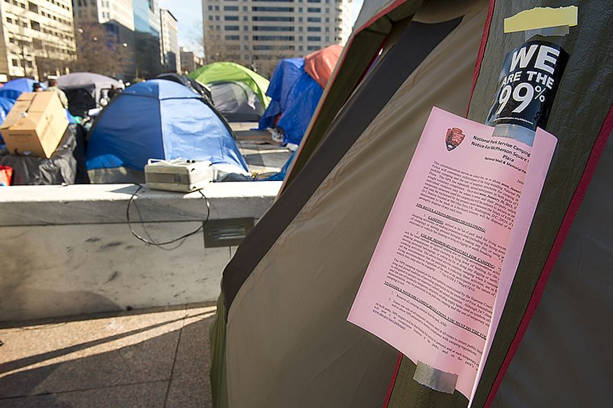 A notice from the Park Police indicating that Occupy protesters will not be allowed to sleep in their tents anymore is taped to a tent at the Freedom Plaza Occupy encampment on Monday, Jan. 30, 2012, the day that Park Police said they would begin to enforce the no camping laws. In anticipation, Occupiers have cleaned out their tents and removed any sleeping bags and pillows. As of 1:30 p.m. no police had shown up. (Barbara L. Salisbury/The Washington Times)