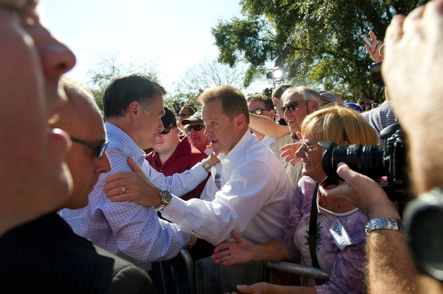 Republican presidential candidate and former Massachusetts Gov. Mitt Romney greets supporters after a campaign rally at Pioneer Park in Dunedin, Fla., on Jan. 30, 2012, the day before the Florida holds its 2012 GOP presidential primary. (Rod Lamkey Jr./The Washington Times)