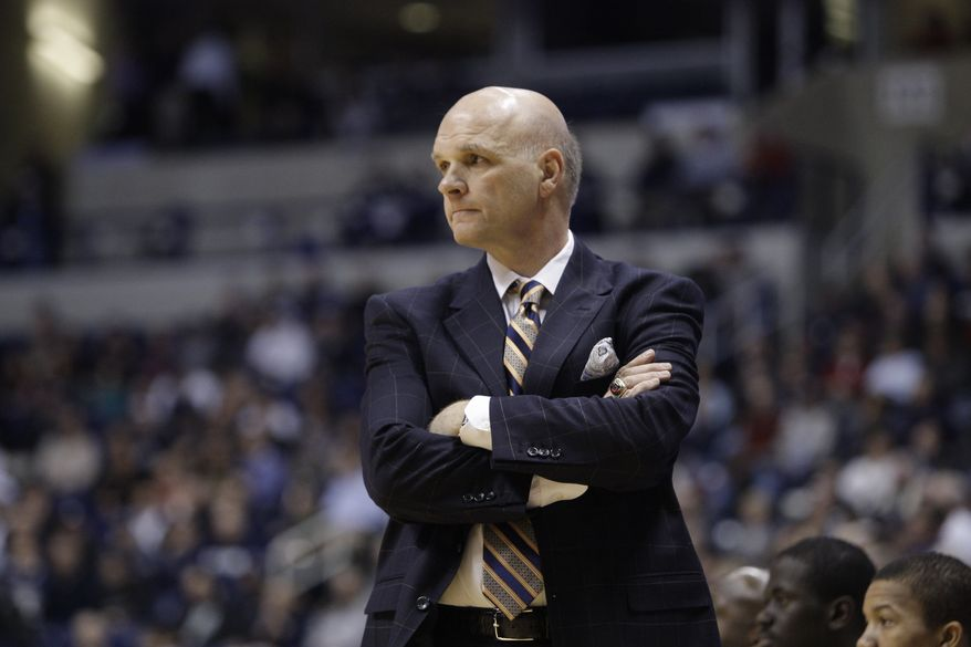 Saint Josephs' head coach Phil Martelli in action against Xavier in an NCAA college basketball game, Wednesday, Jan. 18, 2012, in Cincinnati. (AP Photo/Al Behrman)