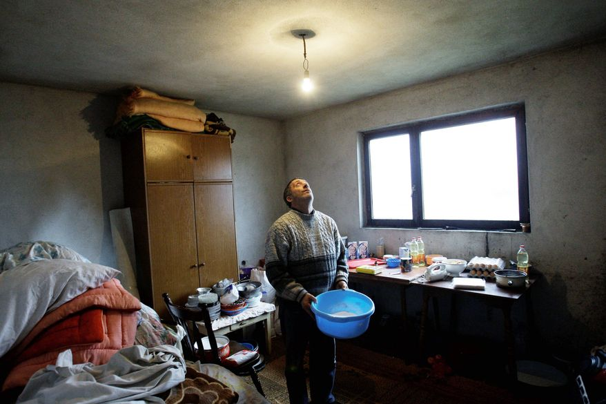 Slavko Rasevic has a blinking light bulb in his home that is powered through an extension cord stretching from his neighbor's house. He is one of the Serb veterans who was forced out of the Bosnian army after age 35, but didn't receive his promised pension checks. Many who fell into poverty are receiving unimaginable help from bitter enemies during the Bosnian War. (Associated Press)