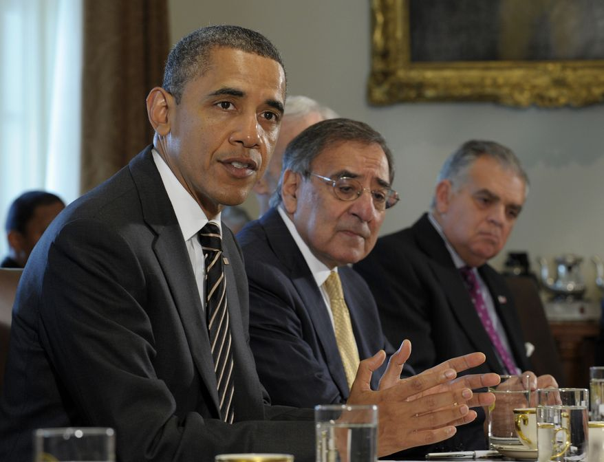 President Obama, sitting next to Defense Secretary Leon Panetta (center) and Transportation Secretary Raymond LaHood (right), speaks Jan. 31, 2012, during a cabinet meeting at the White House. (Associated Press)
