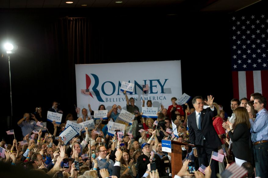 Republican presidential candidate and former Massachusetts Governor Mitt Romney is joined by his wife Ann and other family members on stage as he arrives to deliver his speech to the crowd at the Tampa Convention Center in Tampa, Fla., Tuesday, January 31, 2012. (Rod Lamkey Jr/ The Washington Times)