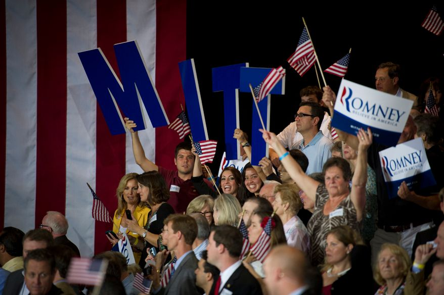 People in the crowd cheer election results as they await the arrival of Republican presidential candidate and former Massachusetts Governor Mitt Romney at the Tampa Convention Center in Tampa, Fla., Tuesday, January 31, 2012. (Rod Lamkey Jr/ The Washington Times)