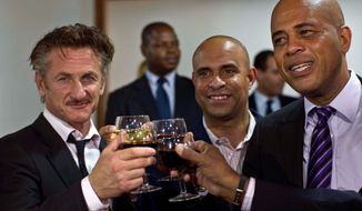 Sean Penn (left) raises a glass with Haiti's President Michel Martelly (right) and Foreign Minister Laurent Lamothe in Port-au-Prince after Mr. Penn was named ambassador at large because of his humanitarian work since the 2010 earthquake. (Associated Press)