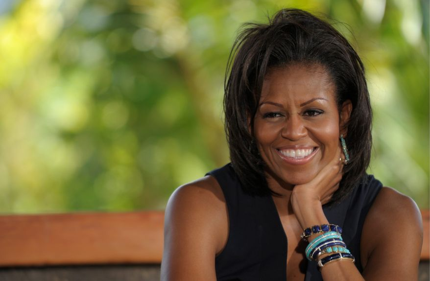 """First lady Michelle Obama has scored a win in her campaign for healthy eating. Tuesday on the """"Tonight Show,"""" she got host Jay Leno, known for his aversion to healthful food, to nibble on apples, sweet-potato fries and a vegetable pizza. (Associated Press)"""