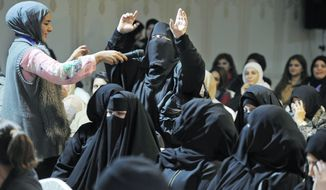 A Kuwaiti woman makes a point at an election rally for candidate Mohammed Al Sagr in Sulaibikhat. Almost 300 are running in Thursday's parliament elections. (Associated Press)