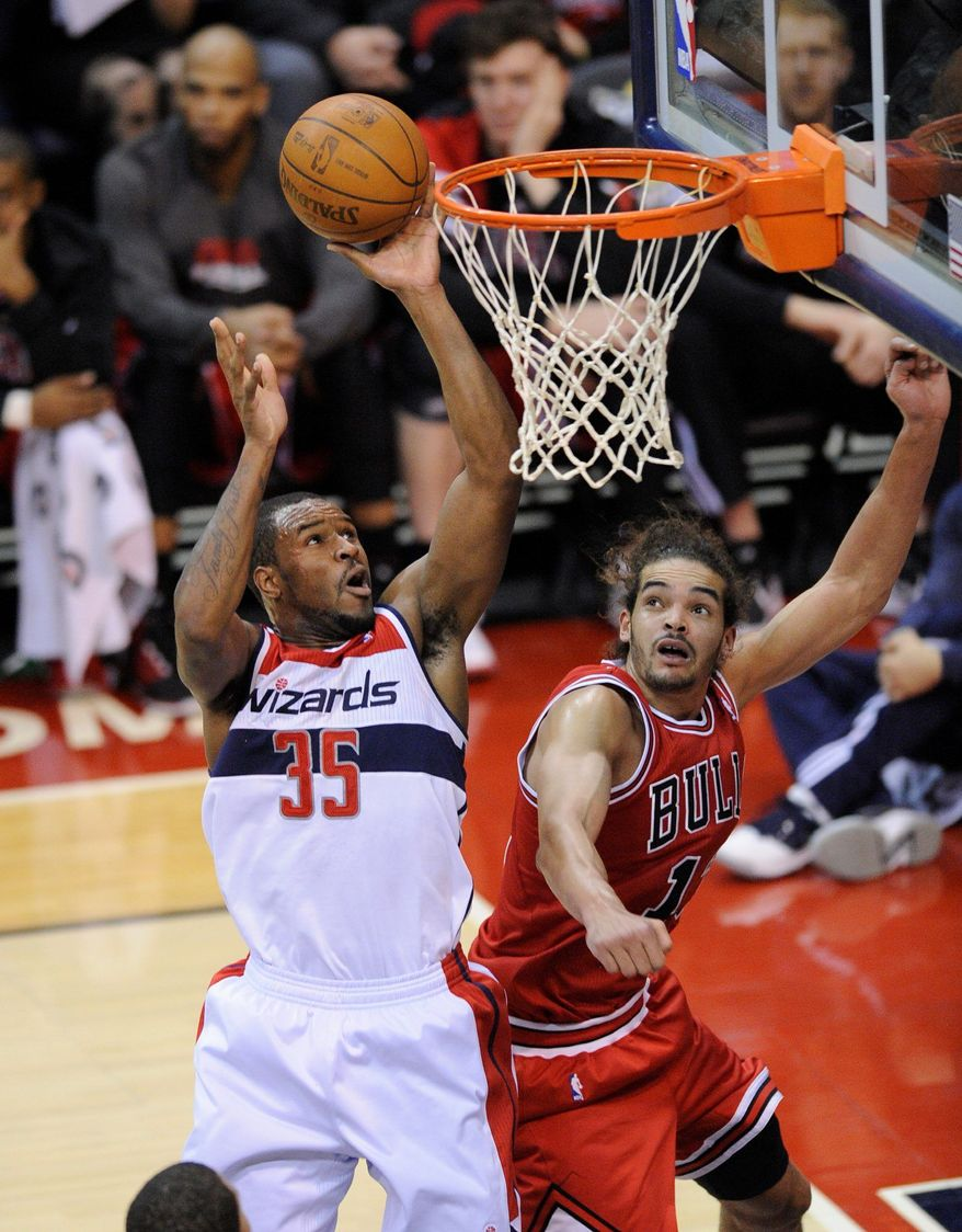 ASSOCIATED PRESS Wizards forward Trevor Booker (left) scored 14 points in each of the two games leading up to Wednesday night's clash with Orlando.