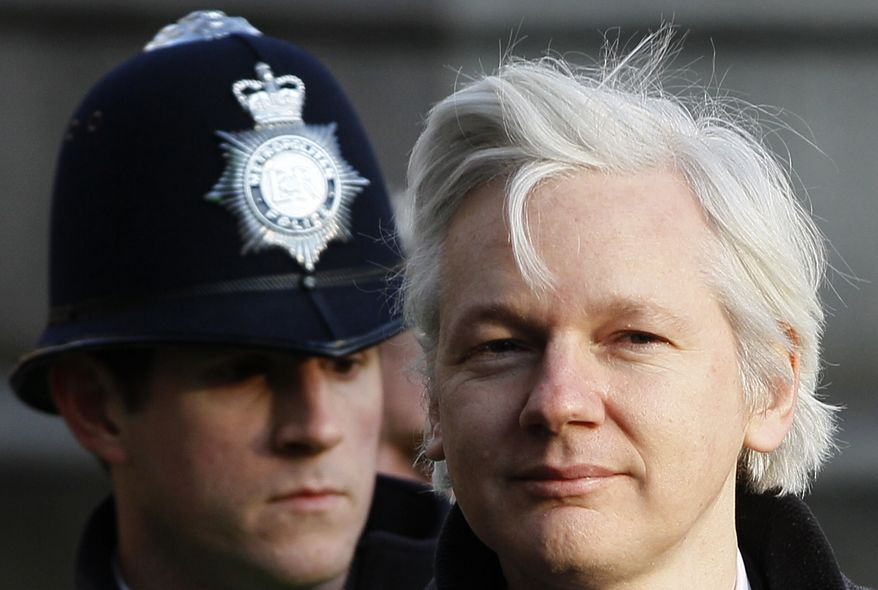 Julian Assange (right), the 40-year-old founder of WikiLeaks, arrives at the Supreme Court in London on Wednesday, Feb. 1, 2012, for a hearing in his extradition case. (AP Photo/Kirsty Wigglesworth)