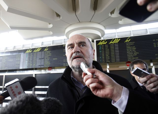 Herman Nackaerts, a deputy director general of the International Atomic Energy Agency, is interviewed upon his arrival from Iran at Schwechat Airport in Vienna, Austria, on Wednesday, Feb. 1, 2012. (AP Photo/Ronald Zak)