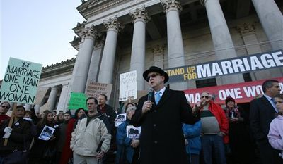 Pastor Joe Fuiten of Cedar Park Assembly of God in Bothell speaks against the pending gay marriage legislation at a noon rally of several hundred, last Monday, Jan. 23, 2012, as legislative hearings regarding the bill are held on the Capitol campus in Olympia, Wash. As lawmakers held their first public hearing on legalizing same-sex marriage, a previously undecided Democratic senator on Monday announced her support for the measure, all but ensuring that Washington will become the seventh state to allow gay and lesbian couples to get married. (AP Photo/The Olympian, Steve Bloom)