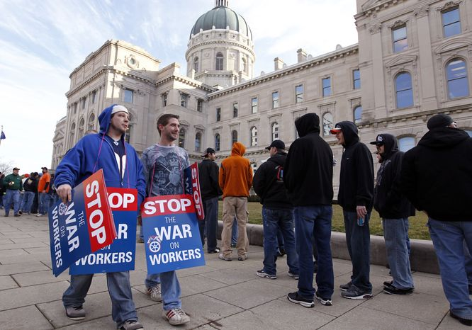 Union members protesting right-to-work legislation under consideration in the Indiana Senate wait to enter the Statehouse in Indianapolis on Wednesday, Feb. 1, 2012. (AP Photo/Michael Conroy)