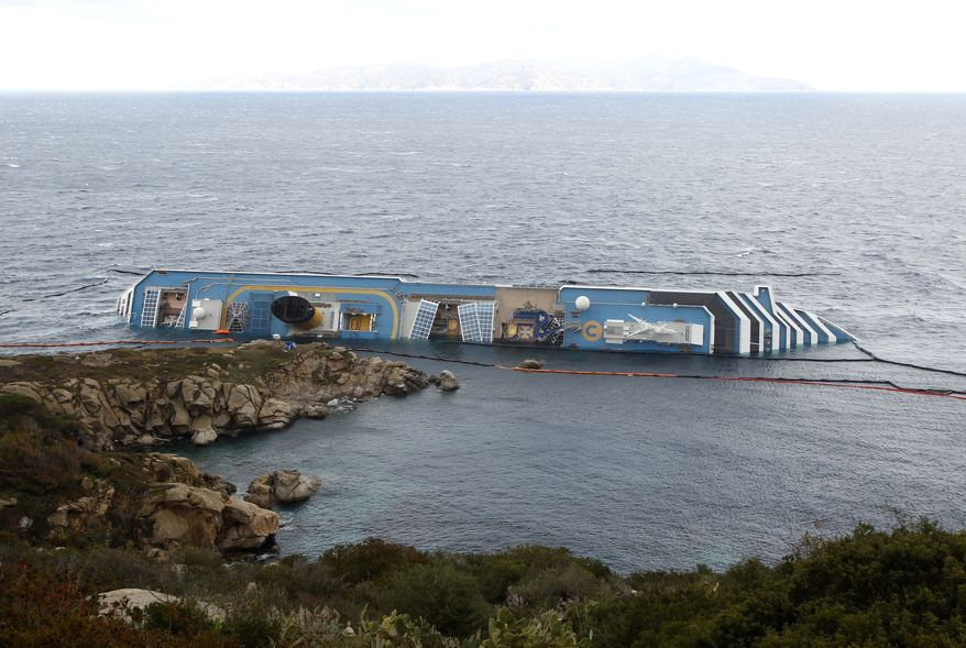 The grounded cruise ship Costa Concordia is seen on Wednesday, Feb. 1, 2012, off the Tuscan island of Giglio, Italy. (Associated Press)