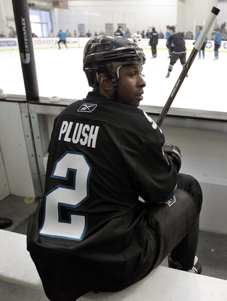 Milwaukee Brewers outfielder Nyjer Morgan watches NHL hockey practice with San Jose Sharks players in San Jose, Calif., Wednesday, Feb. 1, 2012. Morgan, a diehard San Jose fan and former hockey player, got the chance to practice with the team he loves. (AP Photo/Paul Sakuma)