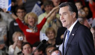 ** FILE ** Republican presidential candidate Mitt Romney celebrates his Florida primary election win at the Tampa Convention Center in Tampa, Fla., on Tuesday, Jan. 31, 2012. (AP Photo/Charles Dharapak)