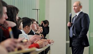 Russian Prime Minister Vladimir Putin meets Feb. 1, 2012, with election monitors in Moscow. (Associated Press/RIA Novosti)