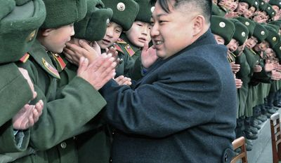 In this undated photo, North Korea's new leader, Kim Jong-un, greets students at Mangyongdae Revolutionary School in Pyongyang, North Korea, on the occasion of the Chinese New Year. Compared with his father, who preceded him as president, Mr. Kim is less aloof and more outgoing. (Associated Press)