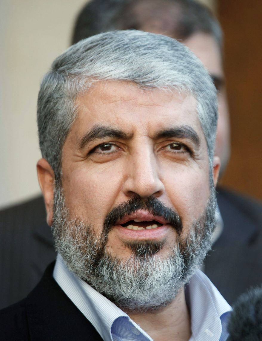 Hamas leader Khaled Mashaal (left) and Palestinian Authority President Mahmoud Abbas are scheduled to meet next week to discuss actions on a deal reached in May to end a 4 1/2-year rift between Hamas and Mr. Abbas' Fatah party. (Associated Press)