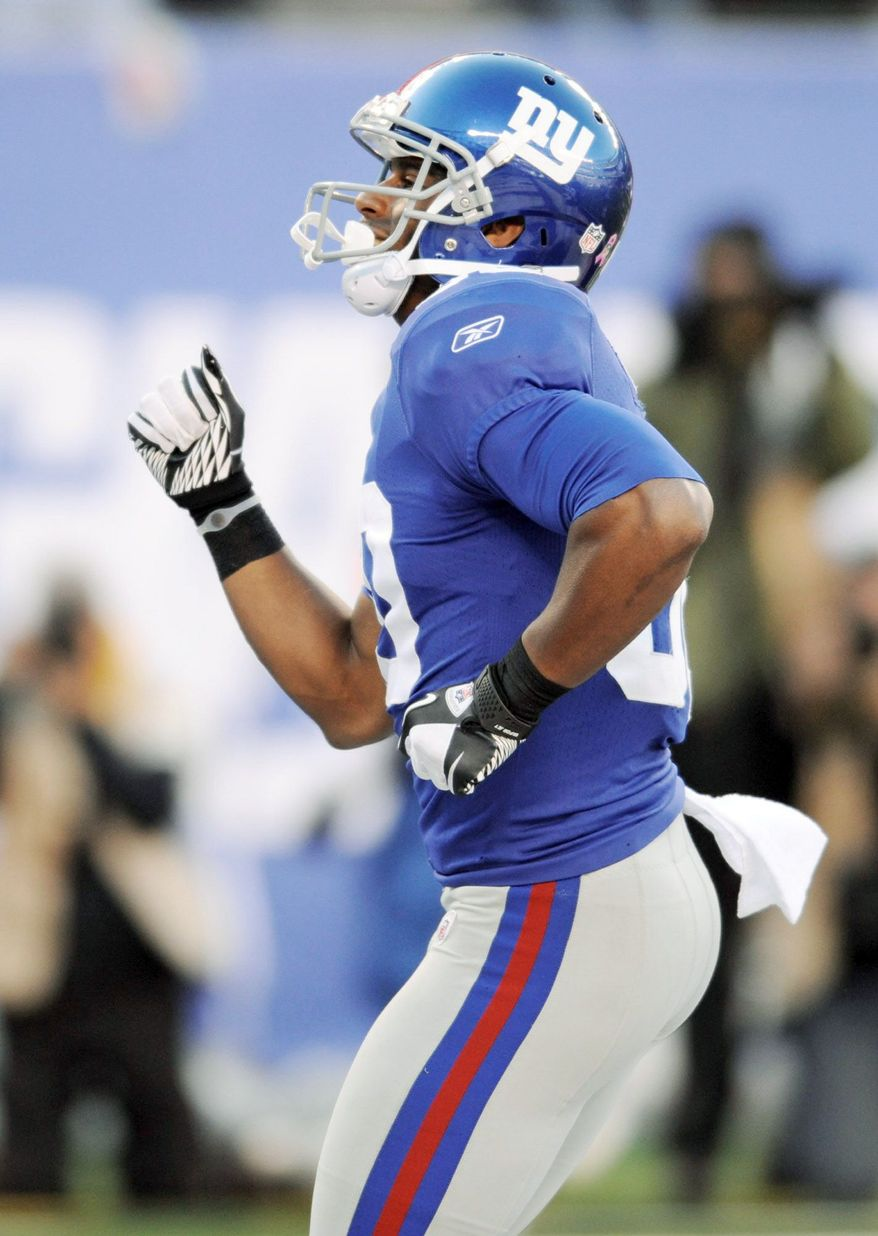 New York Giants wide receiver Victor Cruz, an undrafted free agent out of Massachusetts, racked up 1,536 yards and nine touchdowns as a Giants team that lost twice to the Redskins got hot at the right time. (Associated Press photo)