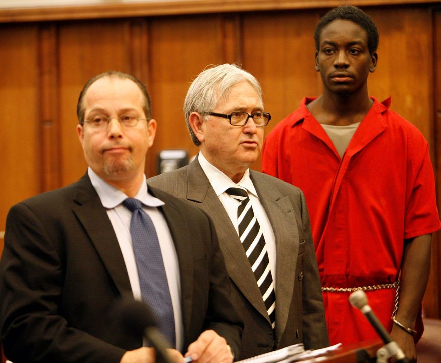 Charles Kendrick Lee (right), charged in the slaying of Washington Redskins safety Sean Taylor, is joined by attorneys David Brener (left) and Wilbur Smith in a Miami courtroom Dec. 21, 2007. (The Associated Press)