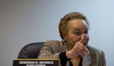 """This is a serious matter,"" D.C. Board of Elections and Ethics Chairwoman Deborah Nichols says to witnesses at a hearing to listen to allegations of petition fraud in gathering signatures to get Ward 7 council member Yvette M. Alexander's name on the April 3 ballot. (Barbara Salisbury/The Washington Times)"