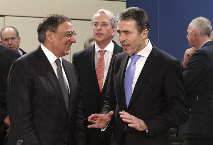 U.S. Secretary of Defense Leon E. Panetta (left) speaks with NATO Secretary-General Anders Fogh Rasmussen during a meeting of NATO defense ministers at NATO headquarters in Brussels on Thursday, Feb. 2, 2012. (AP Photo/Virginia Mayo)