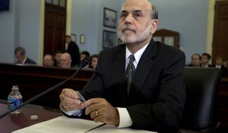 Federal Reserve Chairman Ben S. Bernanke testifies on Capitol Hill before the House Budget Committee on Thursday, Feb. 2, 2012, in Washington. (AP Photo/Carolyn Kaster)