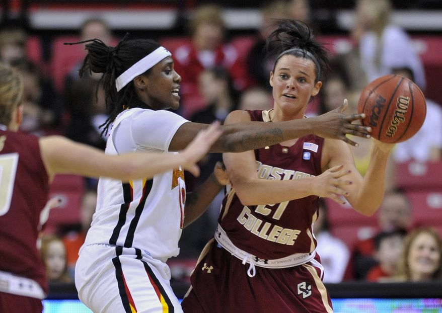 Boston College's Kristen Doherty, right, looks to pass under pressure from Maryland's Lynetta Kizer in the first half of an NCAA basketball game on Thursday, Feb. 2, 2012, in College Park, Md.(AP Photo/Gail Burton)
