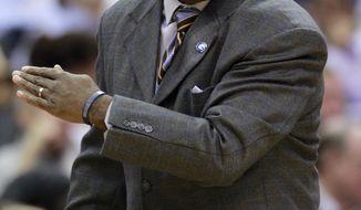 Georgetown head coach John Thompson III reacts to a play during the first half of an NCAA basketball game against Connecticut, Wednesday, Feb. 1, 2012, in Washington. (AP Photo/Haraz Ghanbari)