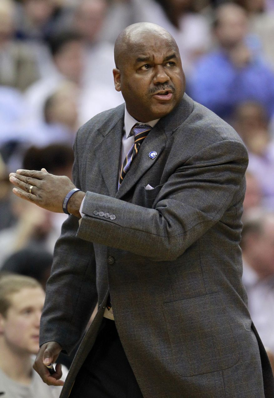 Georgetown head coach John Thompson III reacts to a play during the first half of an NCAA basketball game against Connecticut, Wednesday, Feb. 1, 2012, in Washington. (AP Photo/Haraz Ghanbari)