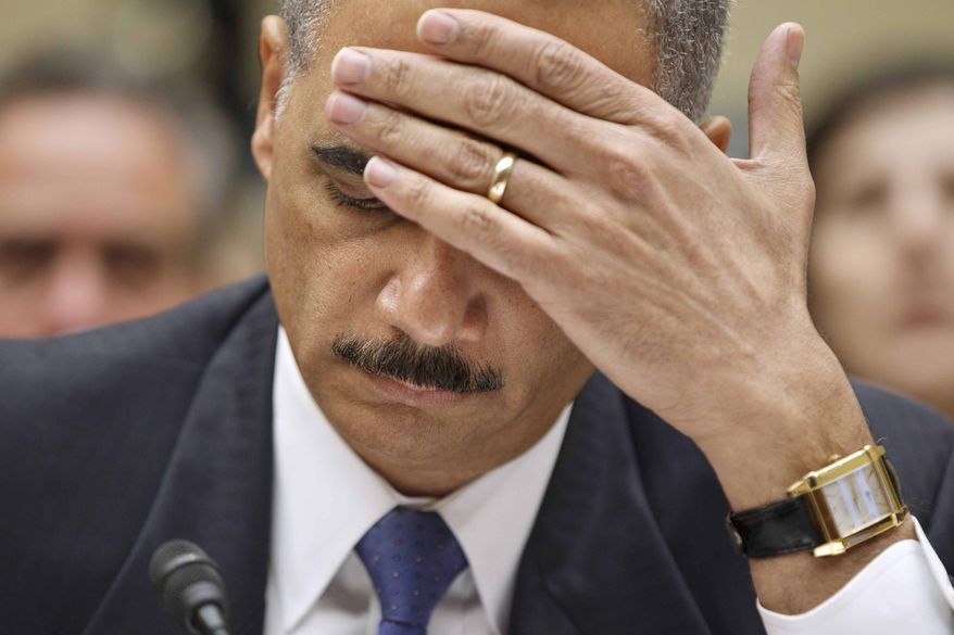 """** FILE ** Attorney General Eric H. Holder Jr. testifies on Capitol Hill in Washington on Thursday, Feb. 2, 2012, before the House Oversight and Government Reform Committee hearing titled """"Fast & Furious: Management Failures at the Department of Justice."""" (AP Photo/J. Scott Applewhite)"""