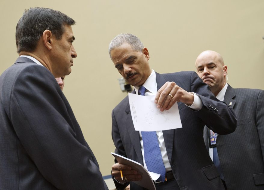 "Attorney General Eric H. Holder Jr. arrives on Capitol Hill in Washington on Thursday, Feb. 2, 2012, to testify before the House Oversight and Government Reform Committee hearing titled ""Fast & Furious: Management Failures at the Department of Justice."" Rep. Darrell Issa, California Republican and committee chairman, is at left. (AP Photo/J. Scott Applewhite)"