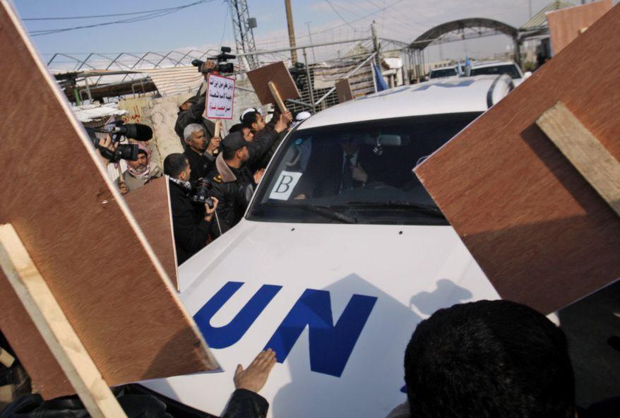 Palestinian demonstrators surround the convoy of U.N. Secretary-General Ban Ki-moon as it enters the Erez border crossing between Israel and Gaza on Thursday, Feb. 2, 2012. (AP Photo/Hatem Moussa)