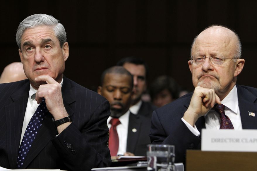 FBI Director Robert S. Mueller III (left) and Director of National Intelligence James R. Clapper testify on Capitol Hill in Washington on Tuesday, Jan. 31, 2012, at a Senate Intelligence Committee hearing to assess current and future national security threats. (AP Photo/Jacquelyn Martin)