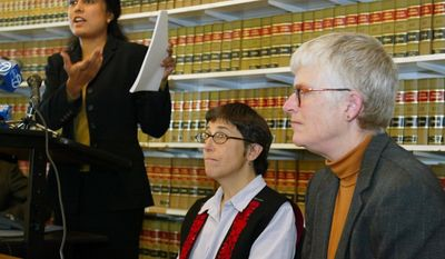 ** FILE ** Jayashri Srikantiah, staff attorney with the ACLU of Northern California, holds up copies of records showing passengers checked on no-fly lists from San Francisco International Airport, as plaintiffs Jan Adams, right, and Rebecca Gordon, center, look on during a news conference in San Francisco, in this April 22, 2003, file photo. (AP Photo/Eric Risberg, File)