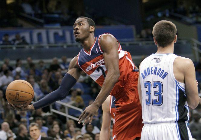 ** FILE ** Washington Wizards' John Wall, left. (AP Photo/John Raoux)