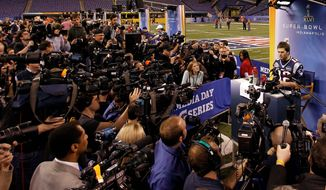 New England quarterback Tom Brady never fails to draw a crowd during Super Bowl week. (Associated Press)