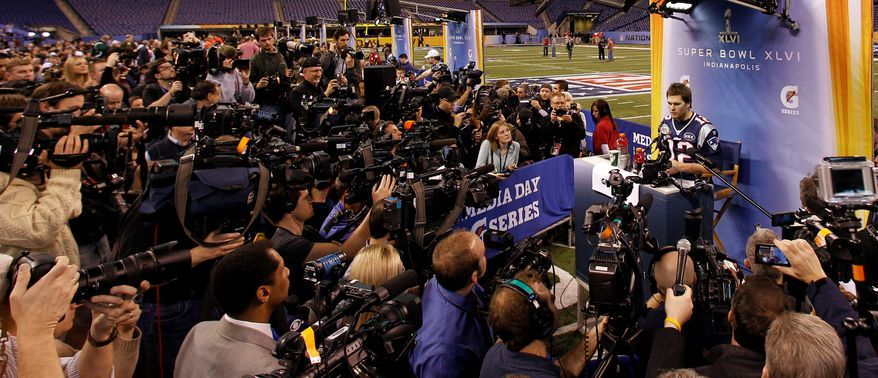 New England quarterback Tom Brady never fails to draw a crowd during Super Bowl week. (Associated Press)
