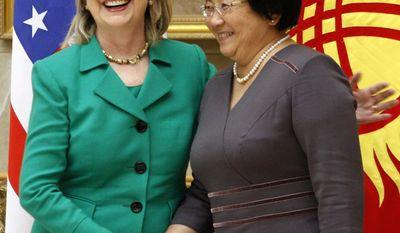**FILE** Secretary of State Hillary Rodham Clinton (left) meets with Kyrgyzstan President Roza Otunbayeva in Bishkek on Dec. 2, 2010. (Associated Press)