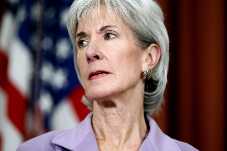 **FILE** Health and Human Services Secretary Kathleen Sebelius is seen Oct. 31, 2011, in the Oval Office at the White House in Washington. (Associated Press)