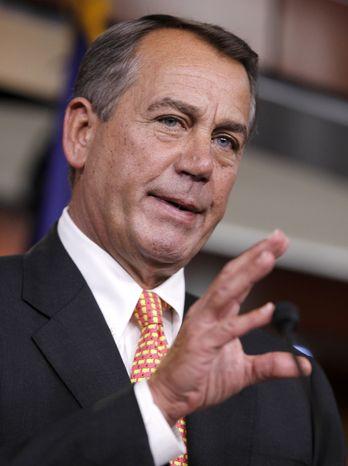 House Speaker John Boehner of Ohio gestures during a news conference on Capitol Hill in Washington, Thursday, Feb. 2, 2012. (AP Photo/Luis M. Alvarez)