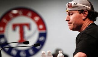 Texas Rangers' Josh Hamilton pauses during a baseball news conference at the Rangers Ballpark in Arlington, Texas, Friday, Feb. 3, 2012. (AP Photo/LM Otero)
