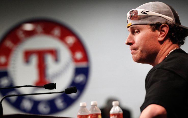 Texas Rangers' Josh Hamilton pauses during a baseball news conference at the Rangers Ballpark in Arlington, Texas, Friday, Feb. 3, 2012. (AP Photo/LM Otero)