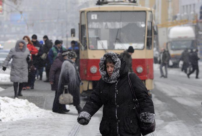 A pedestrian walks Feb. 3, 2012, on a street in Kiev. (Associated Press)