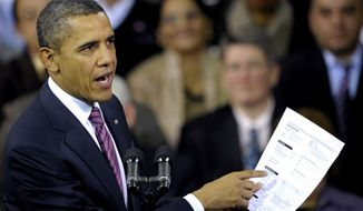 President Barack Obama holds up a proposed mortgage application form as he speaks at the James Lee Community Center in Falls Church, Va., Wednesday, Feb. 1, 2012. (AP Photo/Cliff Owen)