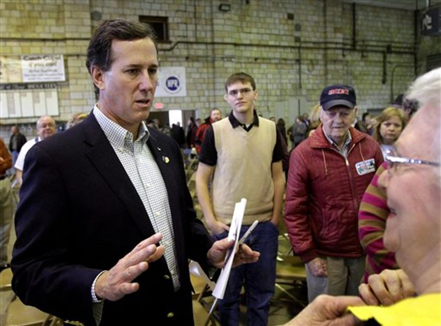 Republican presidential candidate, former Pennsylvania Sen. Rick Santorum answers question from local residents while campaigning in Hannibal, Mo., Friday, Feb. 3, 2012. (AP Photo/Seth Perlman)